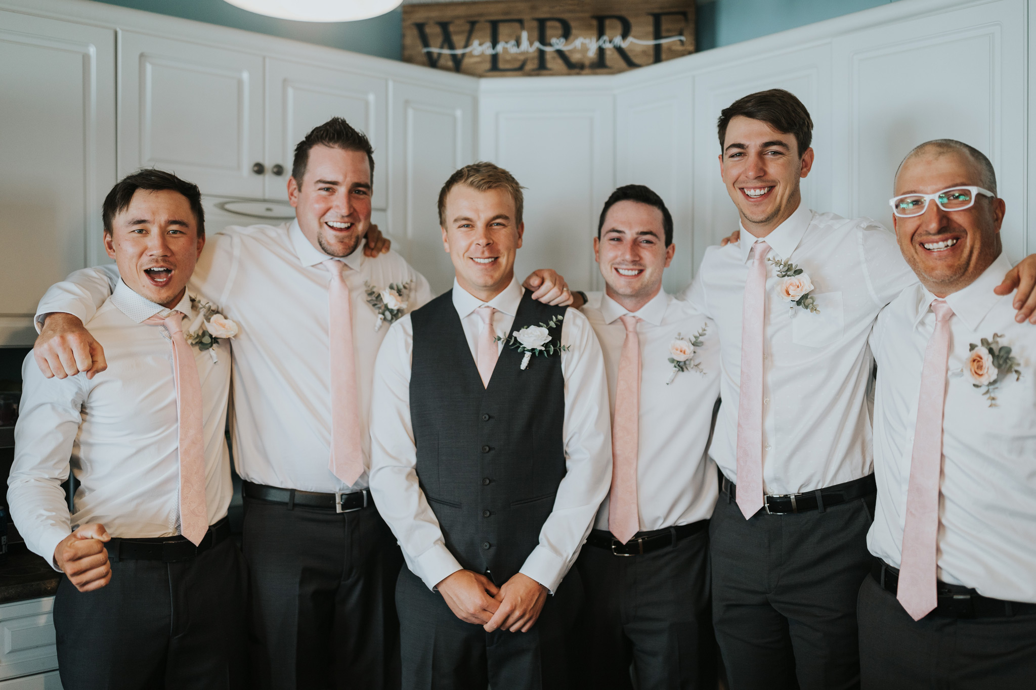 groom with groomsmen happy and excited