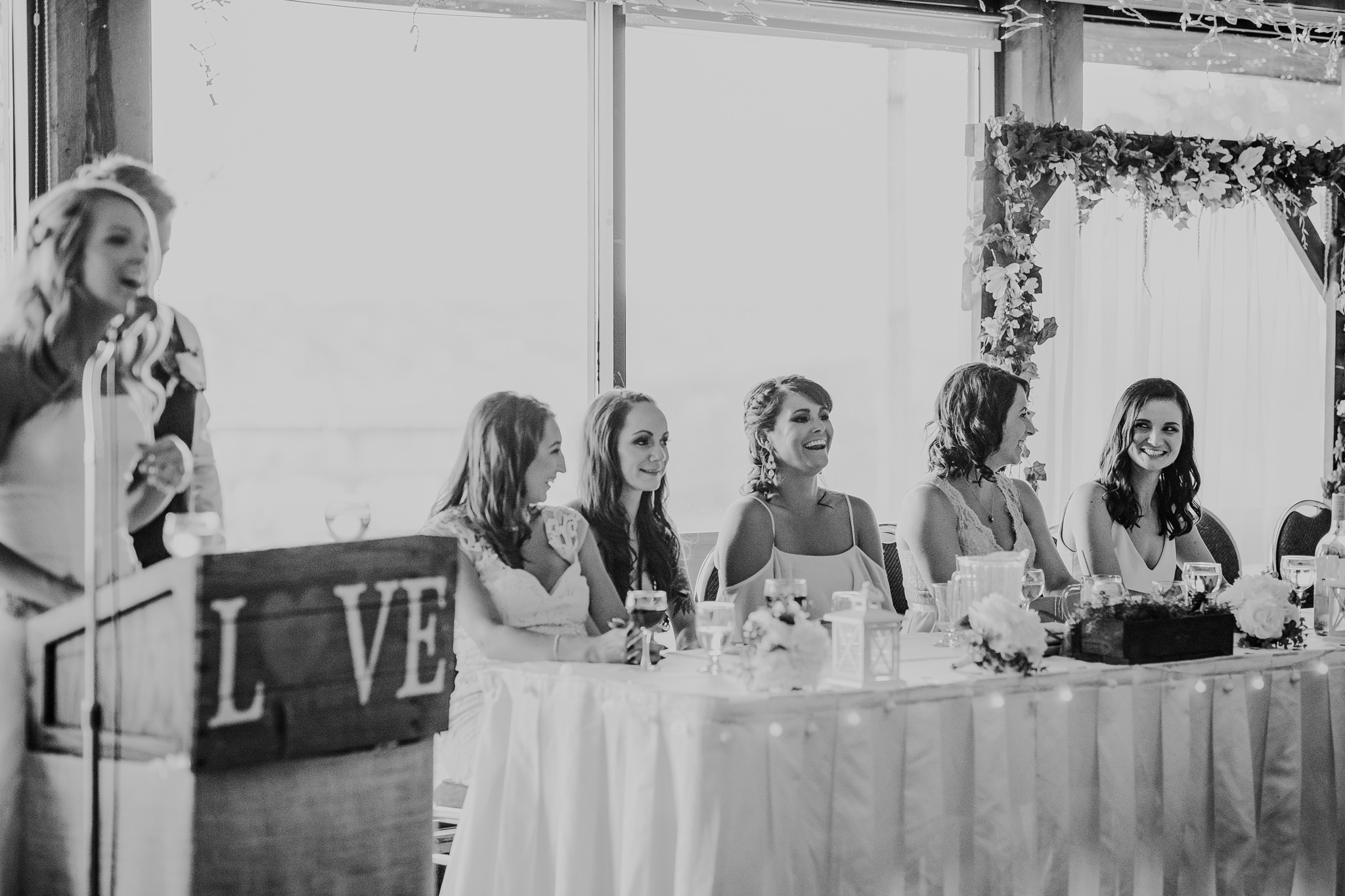 bridesmaids laughing at head table wedding reception