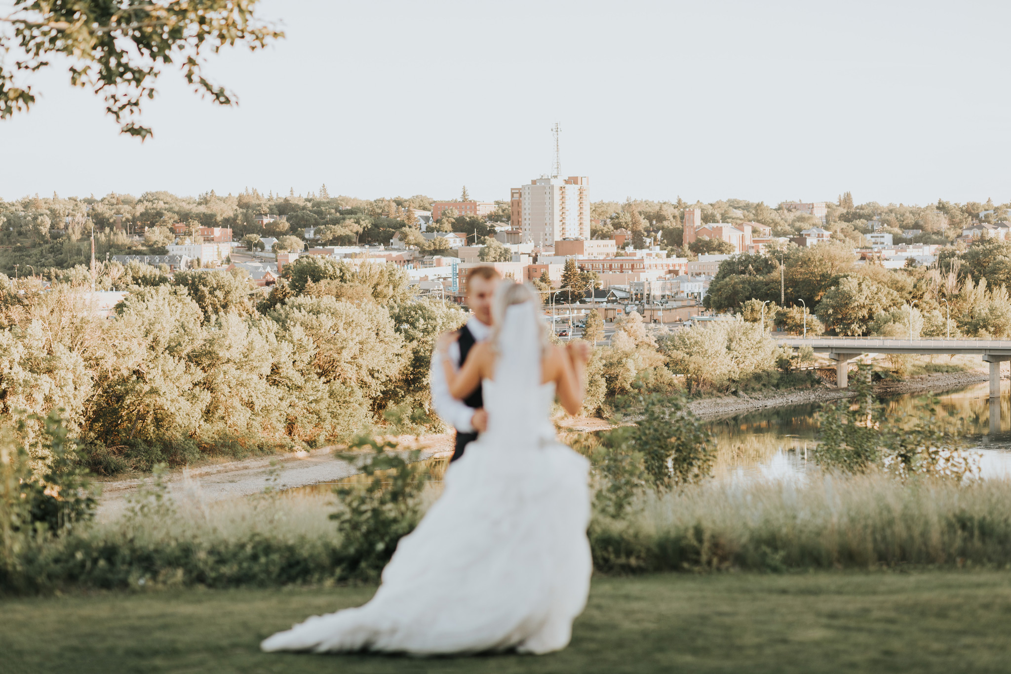 married couple practicing their first dance looking over the city skyline medicine hat alberta