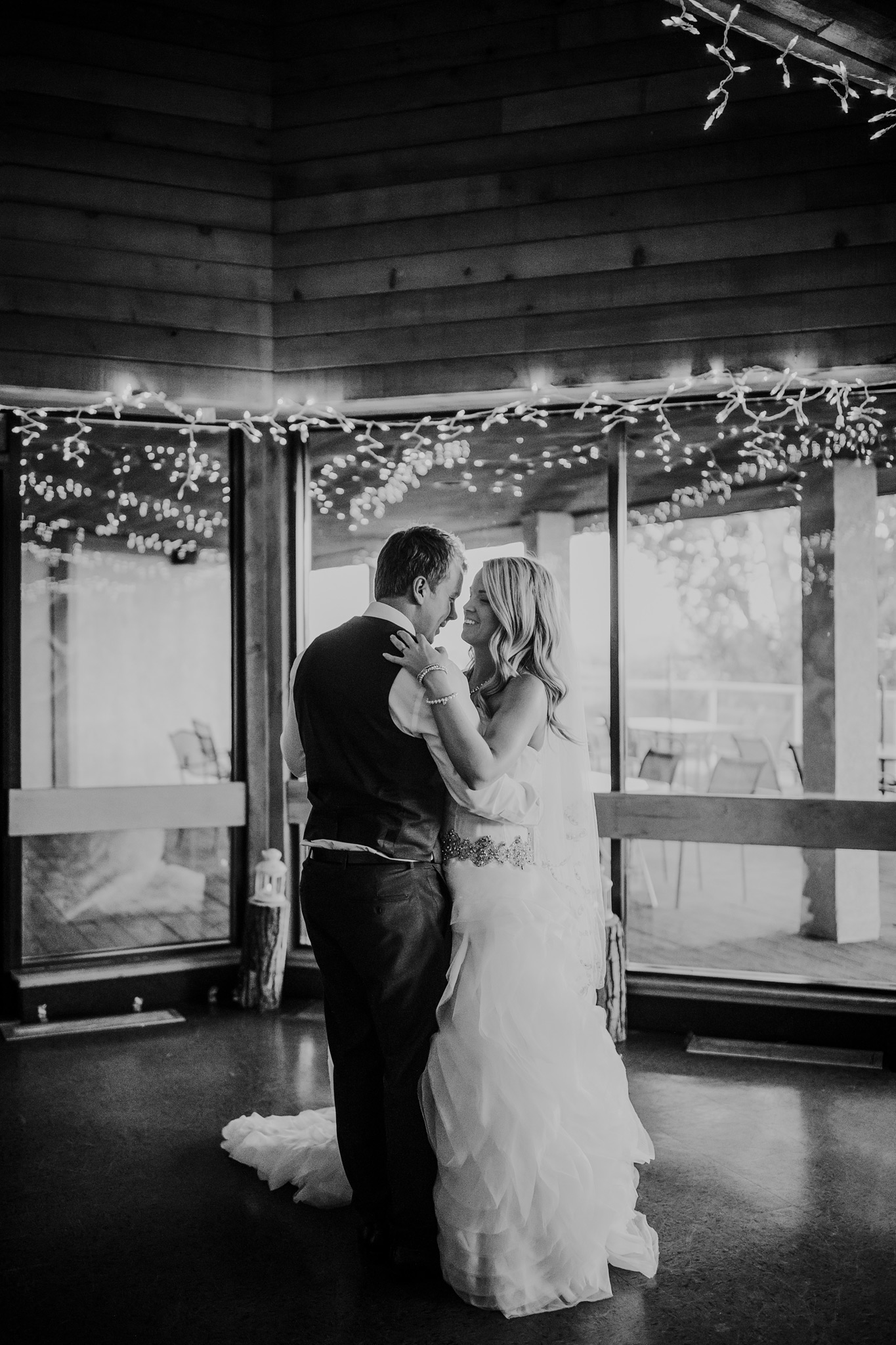 bride and grooms first dance at reception black and white