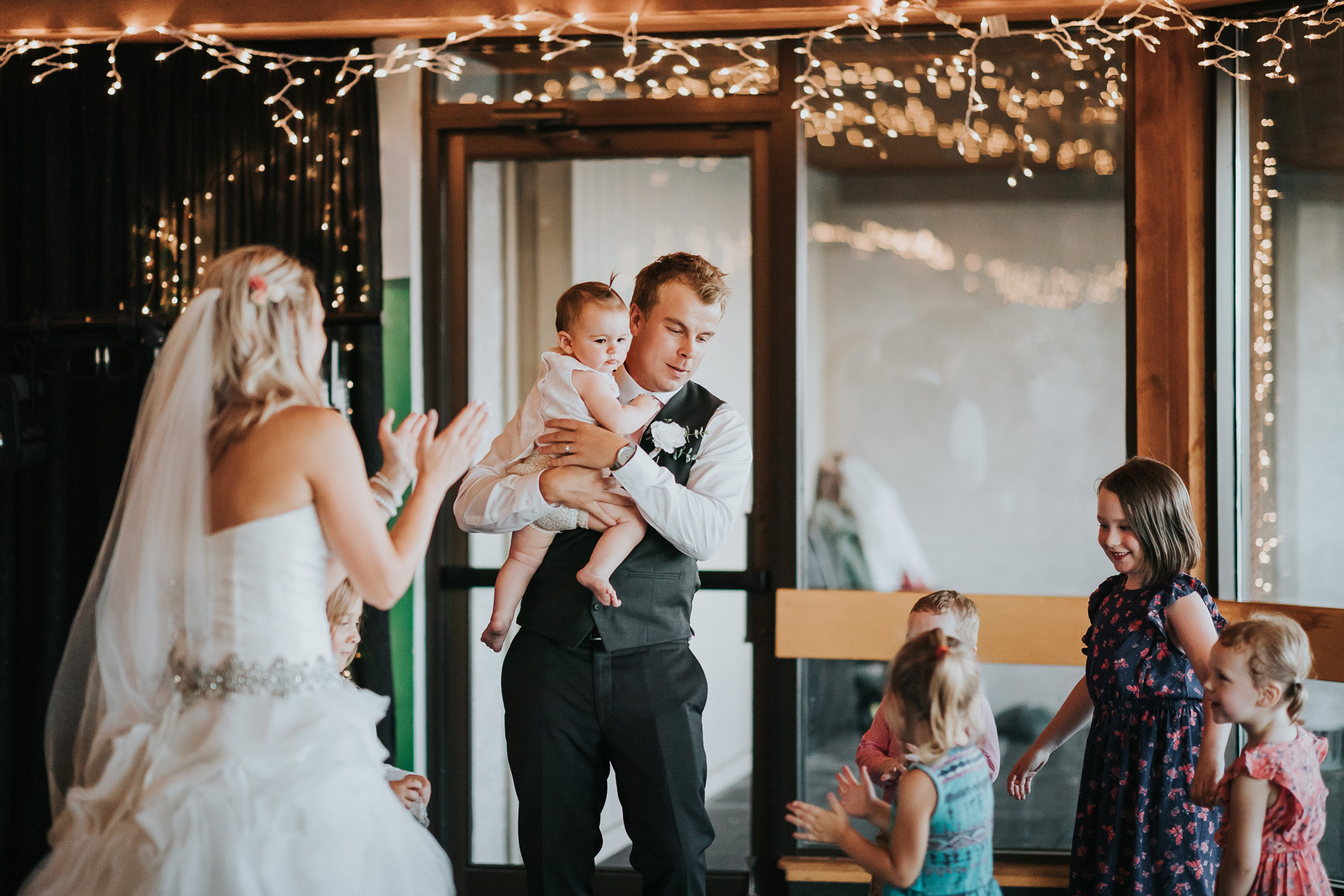 bride and groom dancing with kids and niece during first dance reception