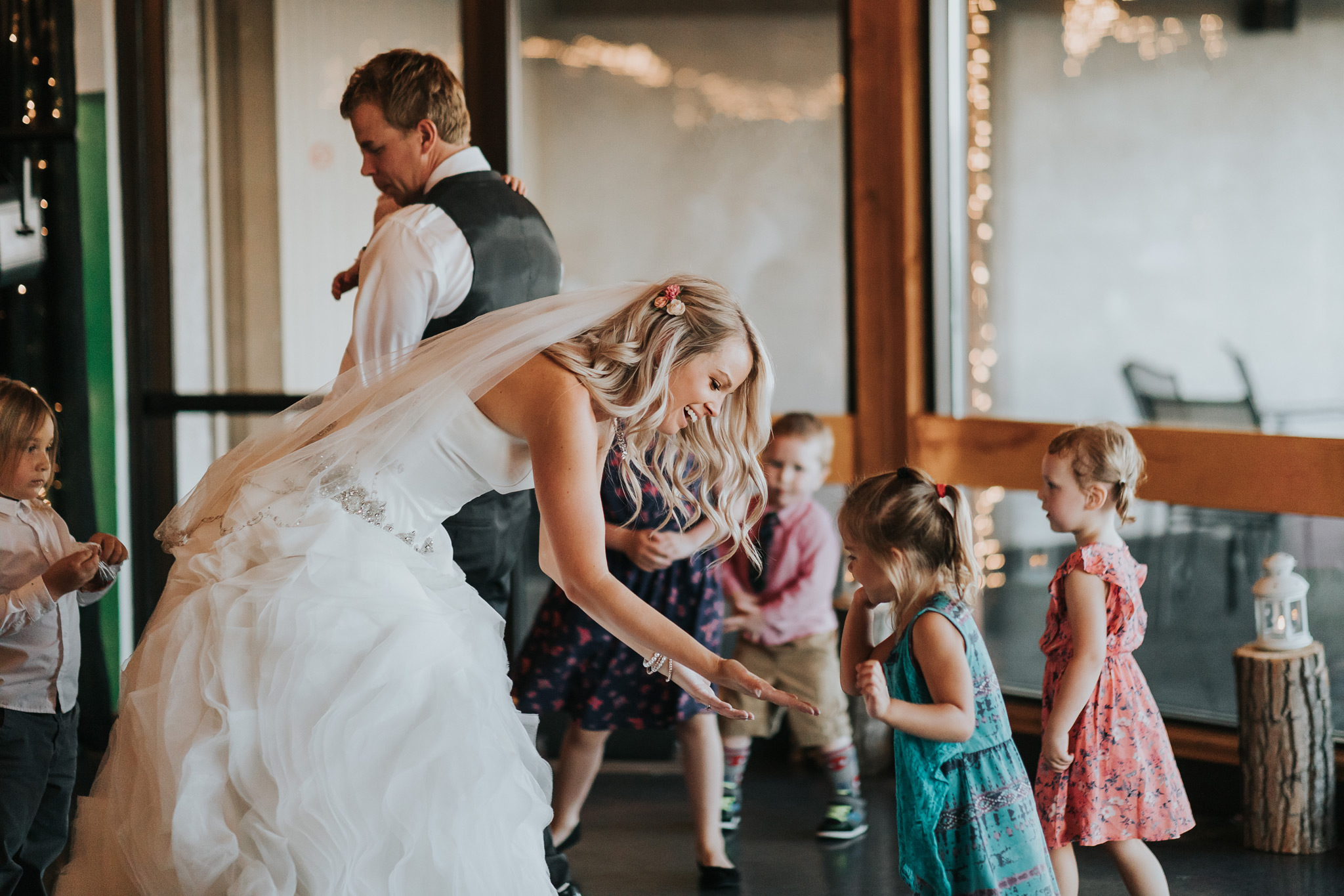 bride high fives girl after dancing at the reception