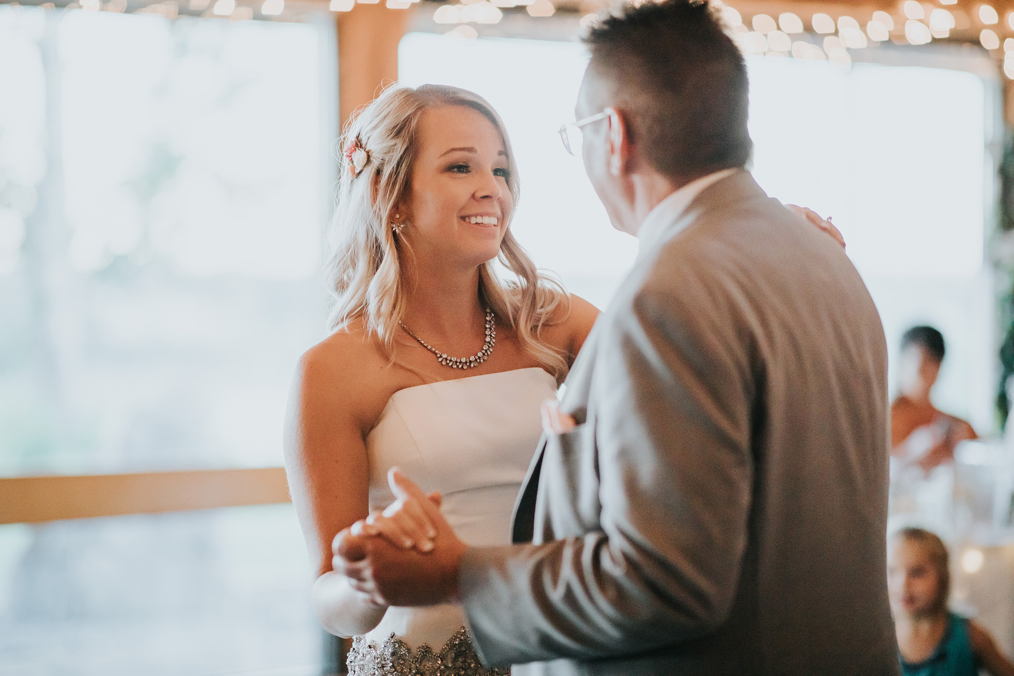 bride smiling dancing with her father