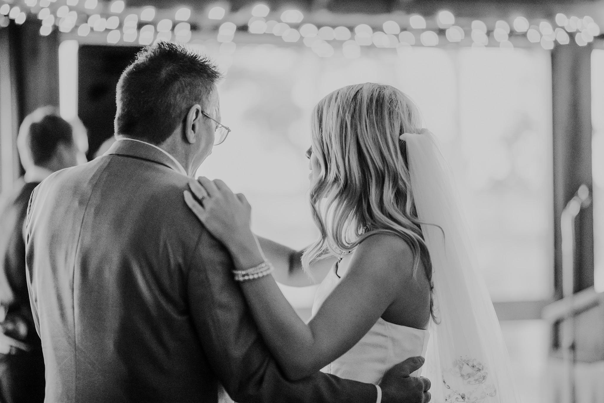 bride dancing with her father black and white photo