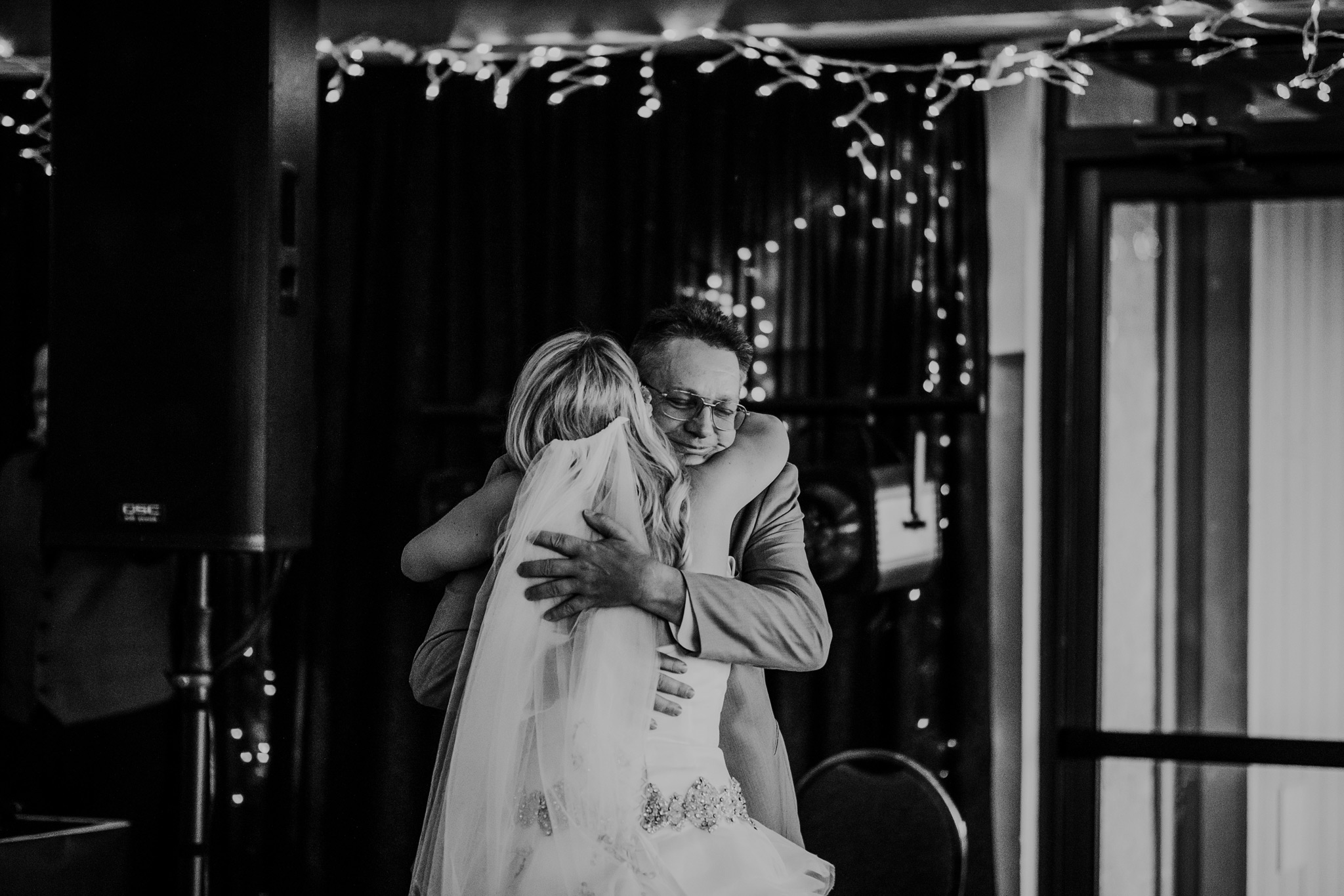 bride hugs her father after dancing