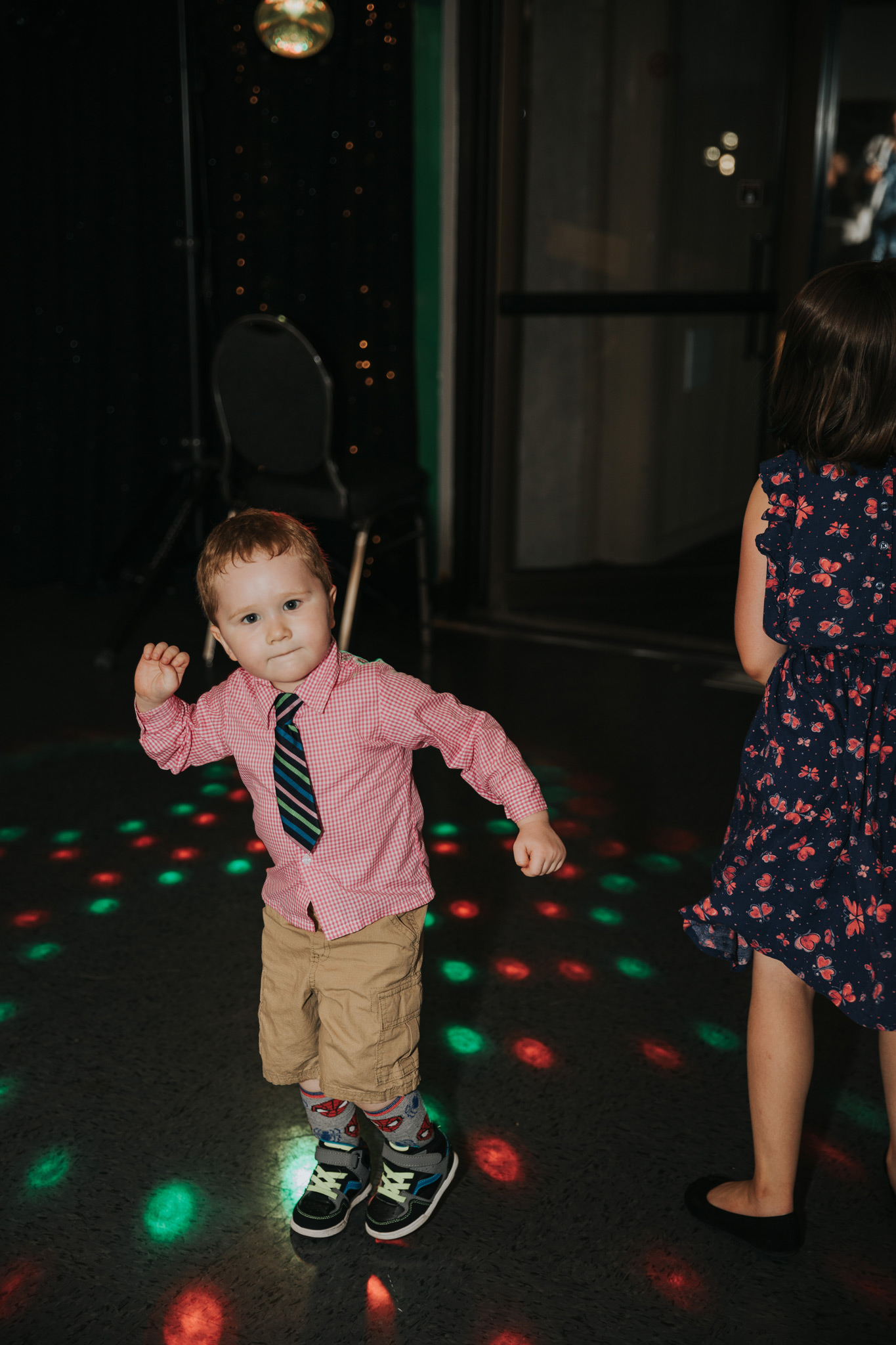 little boy dancing at reception