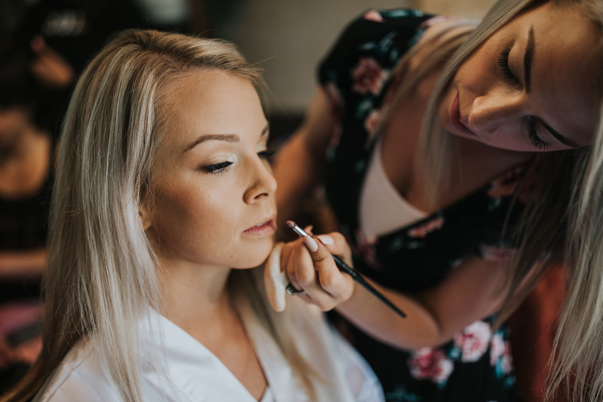bride having her makeup done for her wedding