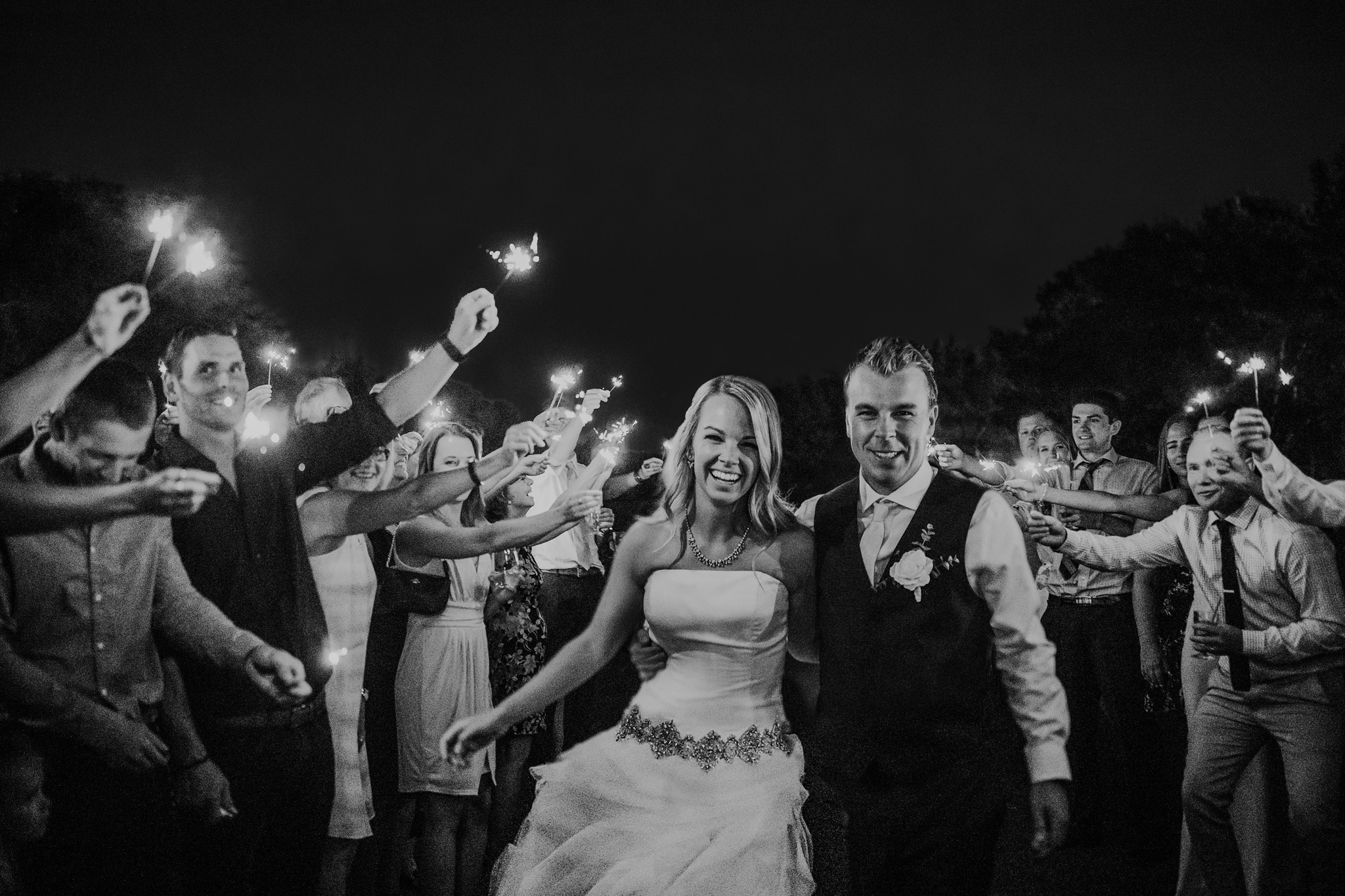 sparkler exit bride and groom walking down aisle of guests holding sparklers