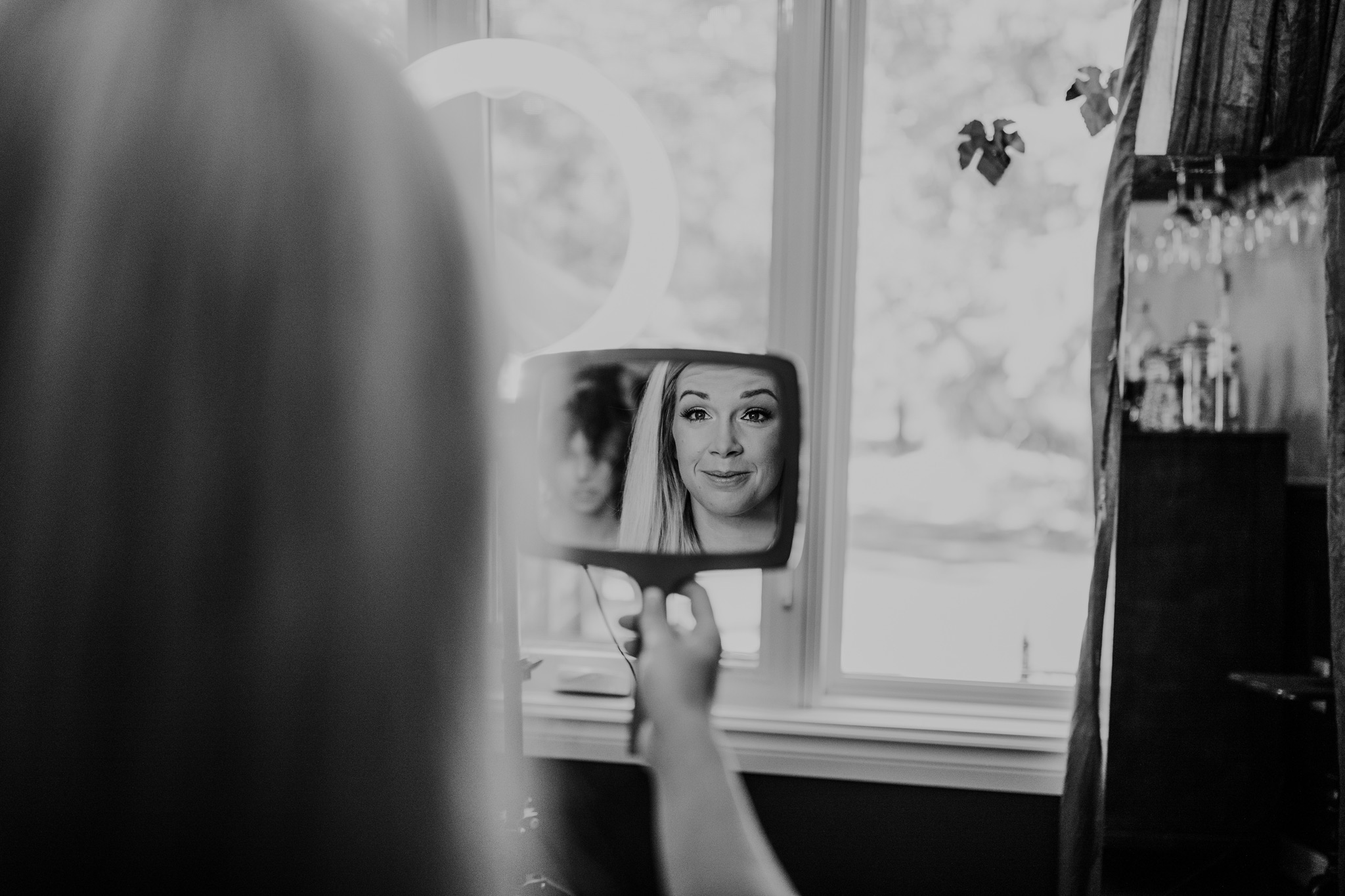 bride seeing her makeup in the mirror for the first time