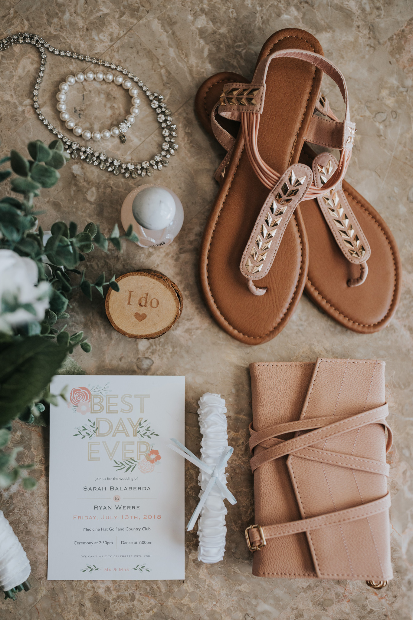 detail flat lay photo of brides wedding accessories, shoes, invitation