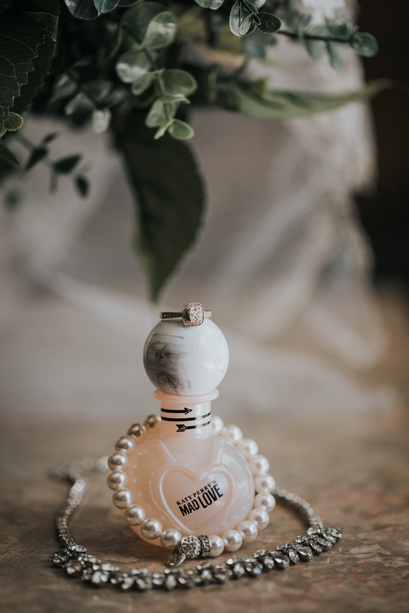 perfume bottle with brides jewelry