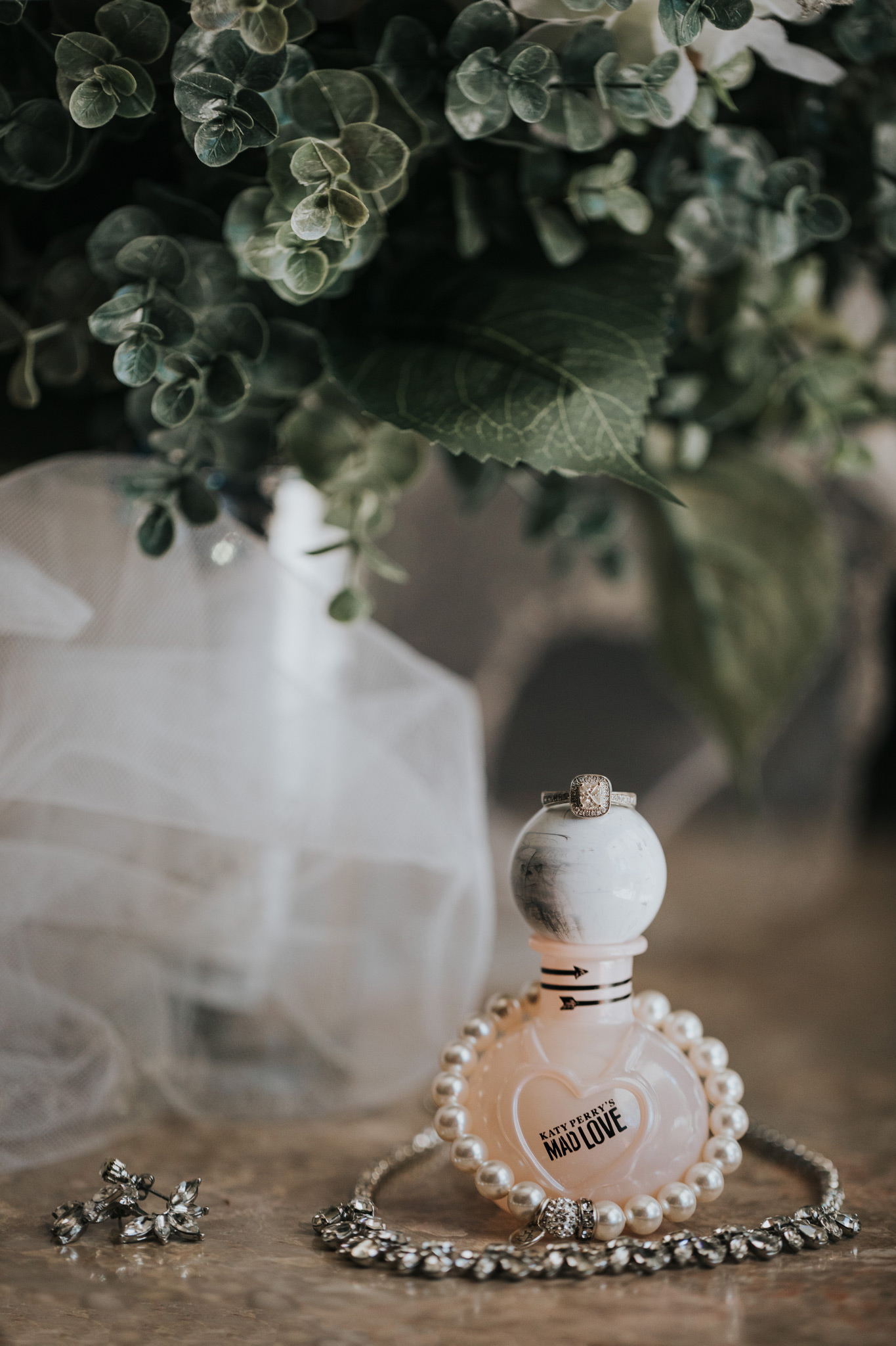 perfume bottle with brides jewelry wedding detail photo