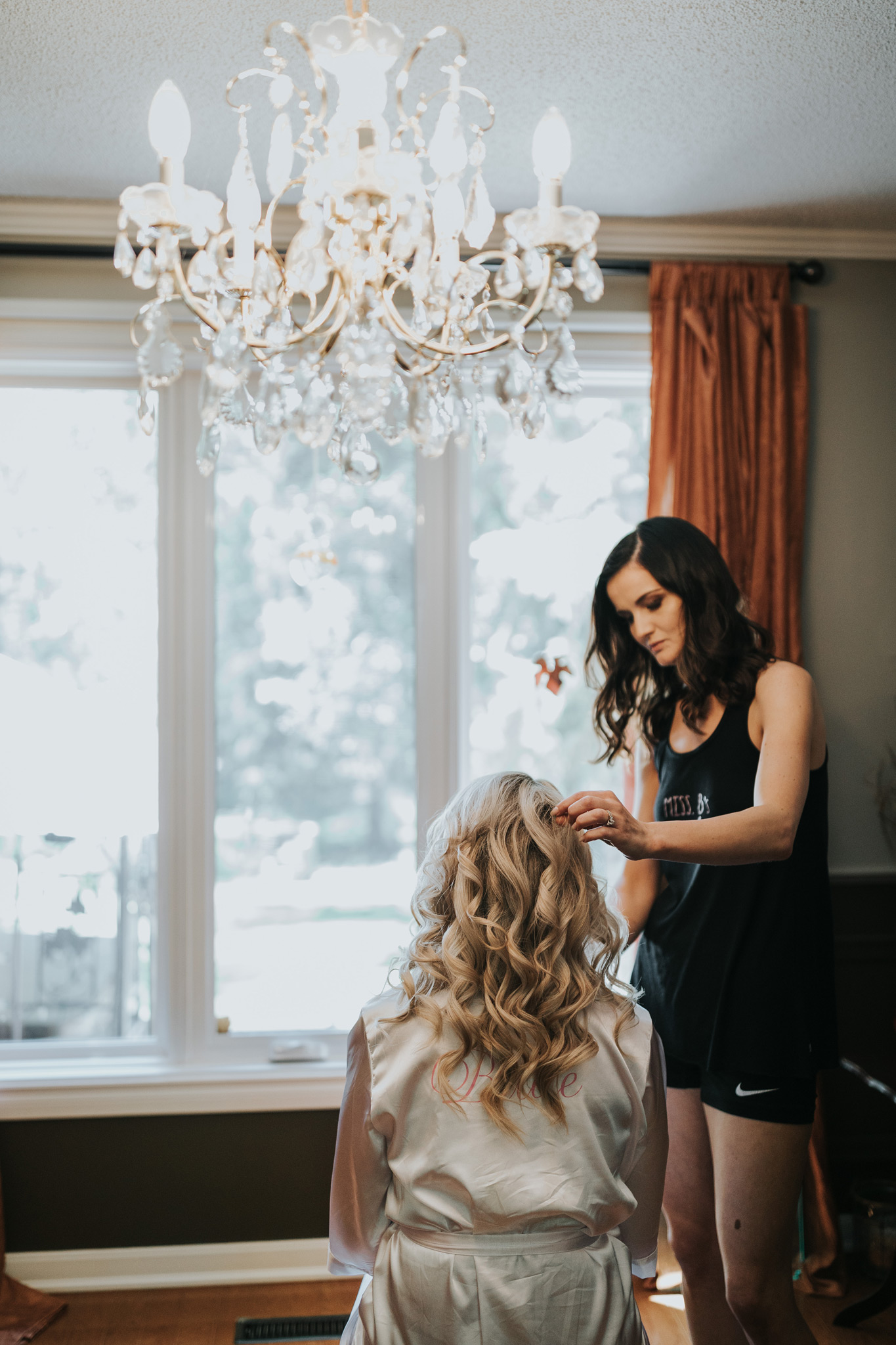 bride having her hair done for her wedding