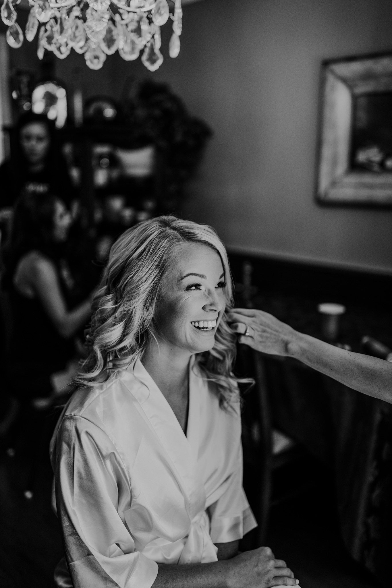 bride laughing and smiling while getting ready