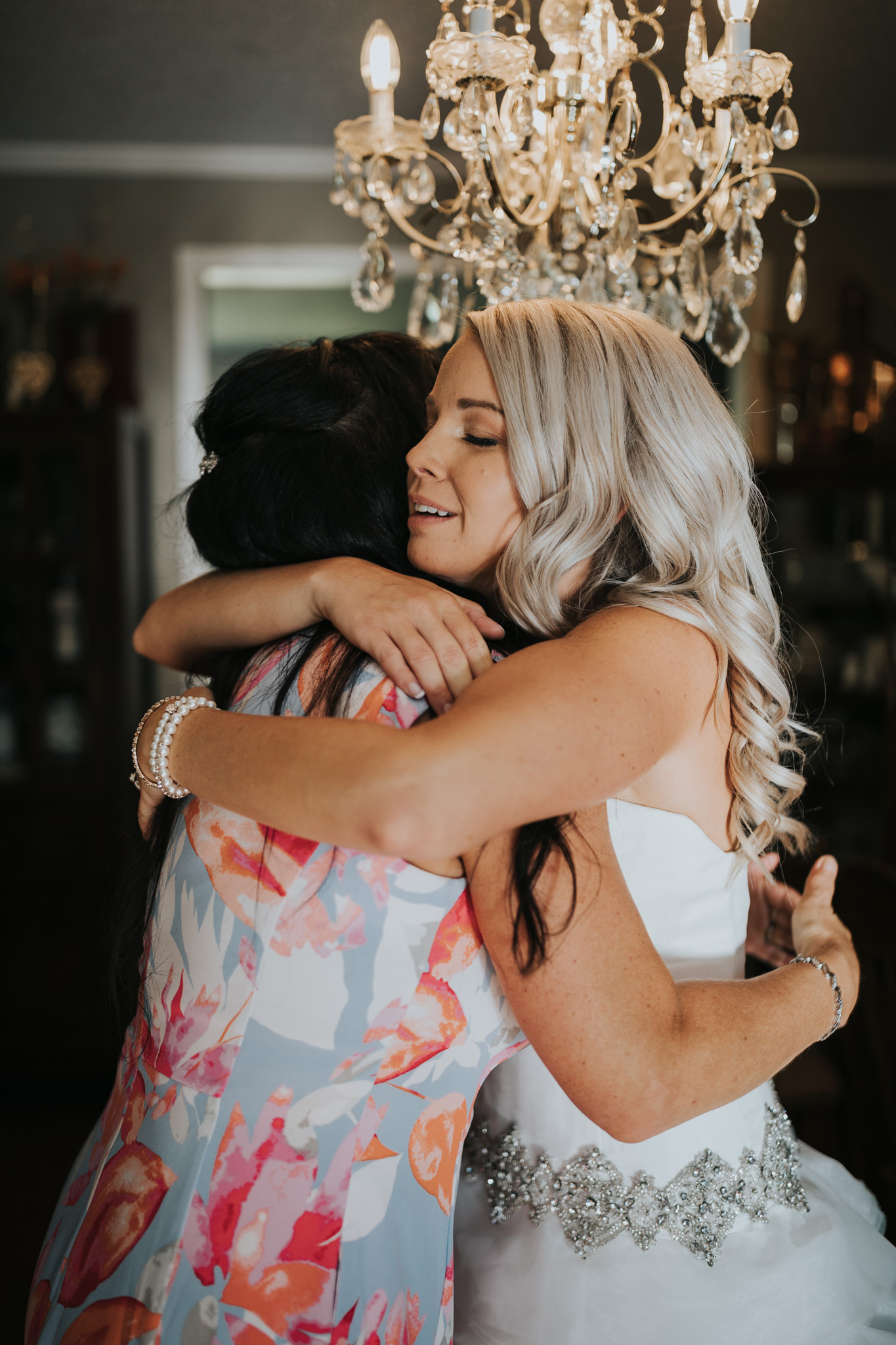 emotional hug between the bride and her mother