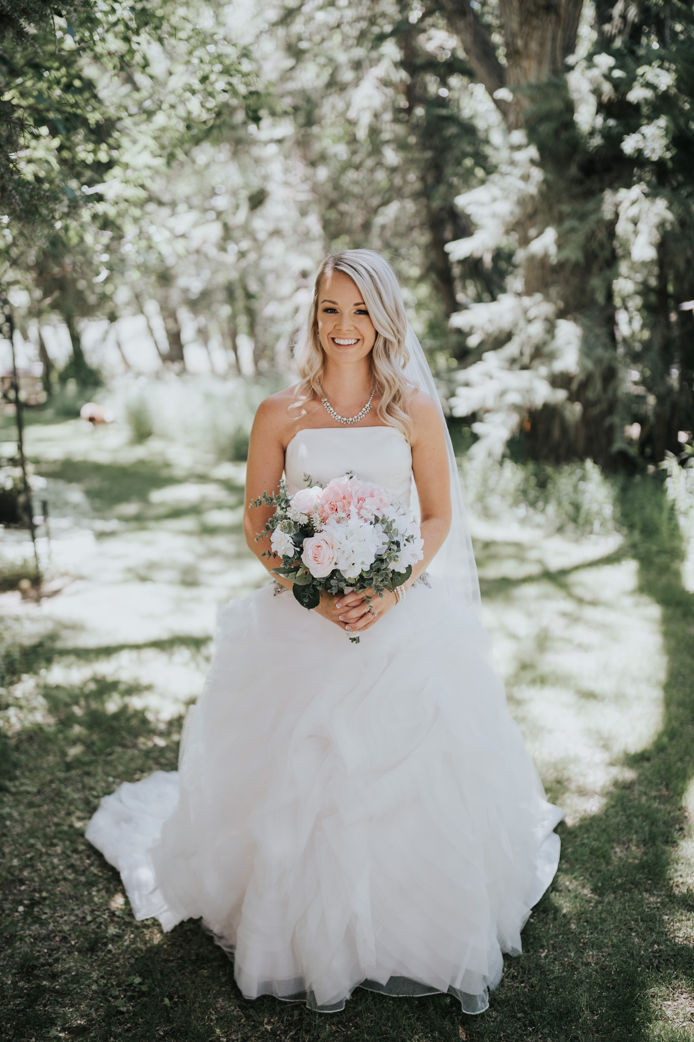 portrait of bride with her wedding bouquet