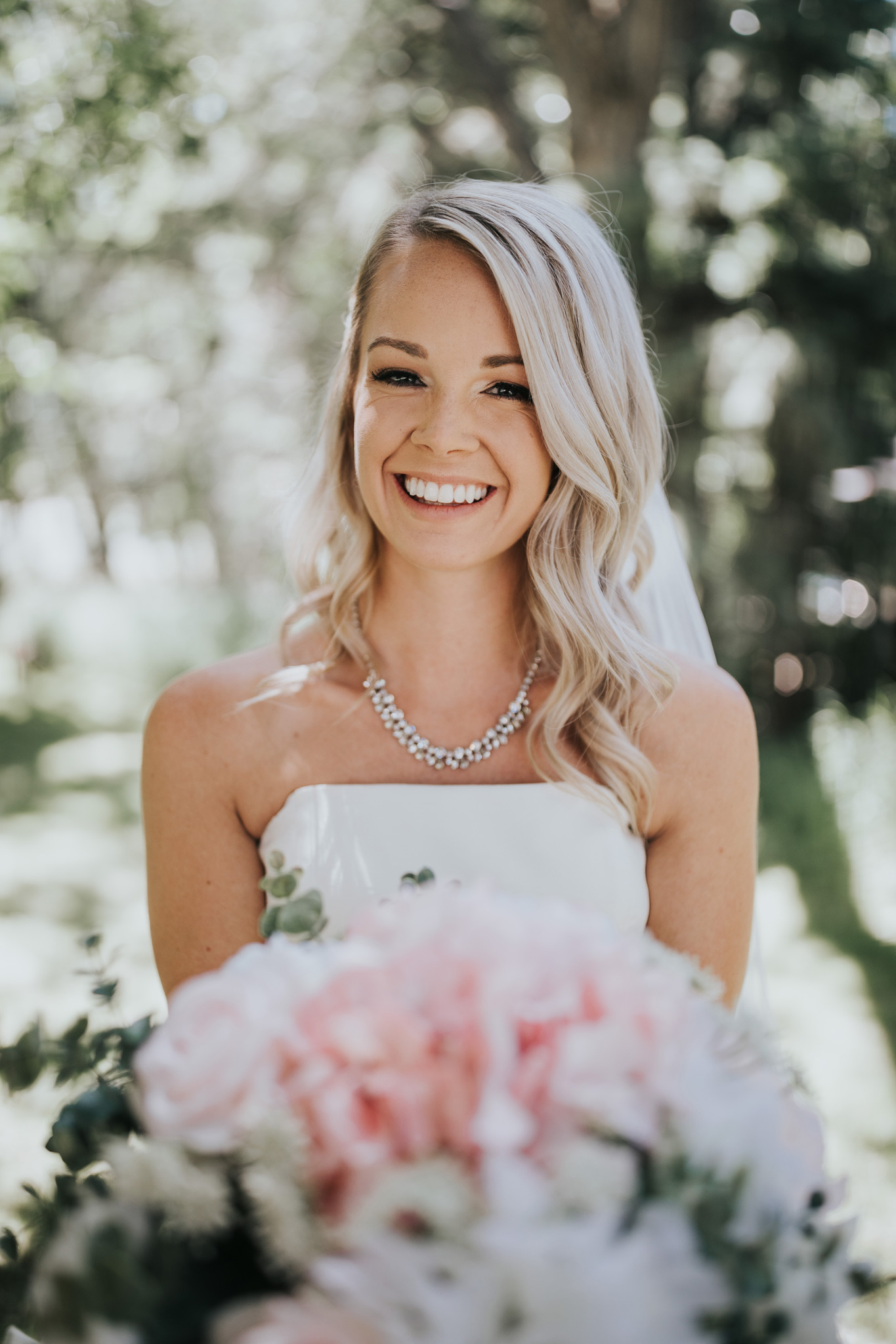 closeup of bride smiling with her bouquet