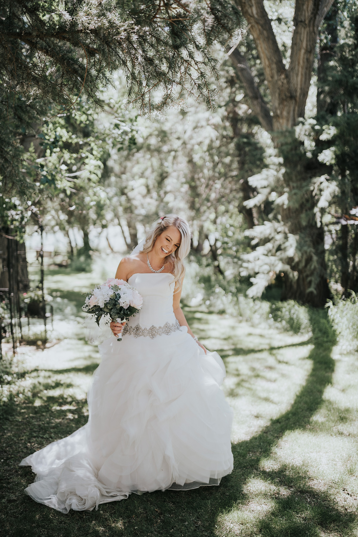 bride twirling in her wedding dress