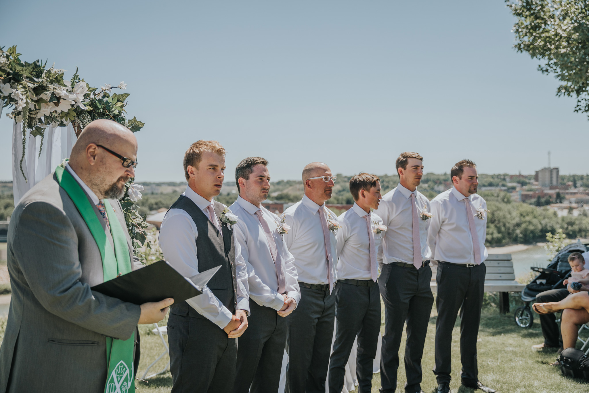 groom and groomsmen standing for the ceremony