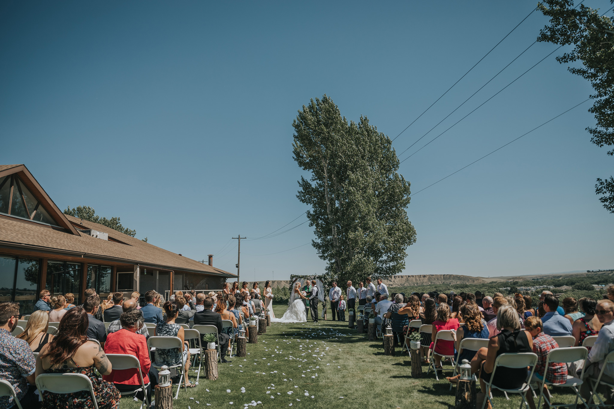 wide shot of ceremony and guests