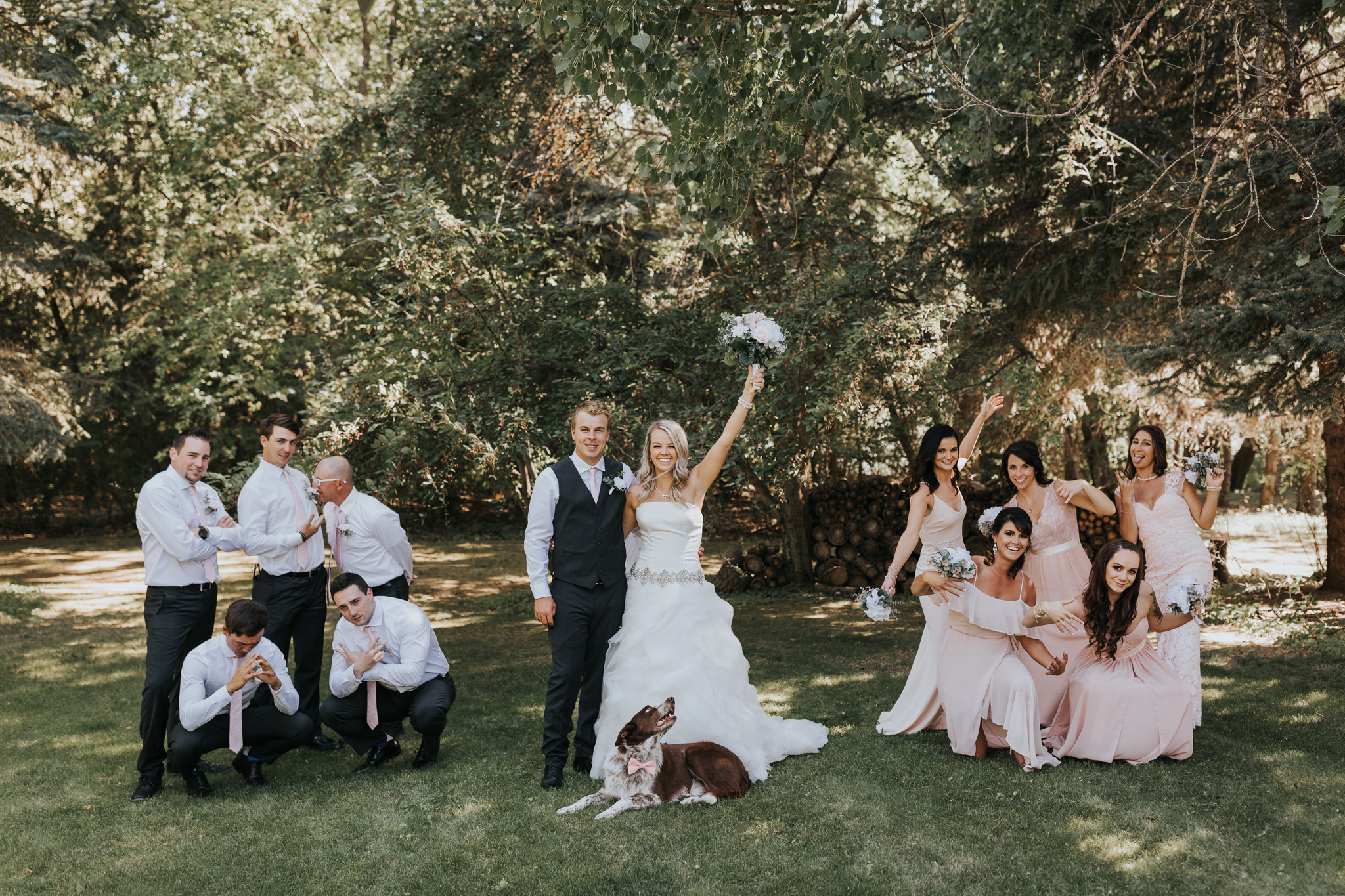 bridal party poses beside bride and groom
