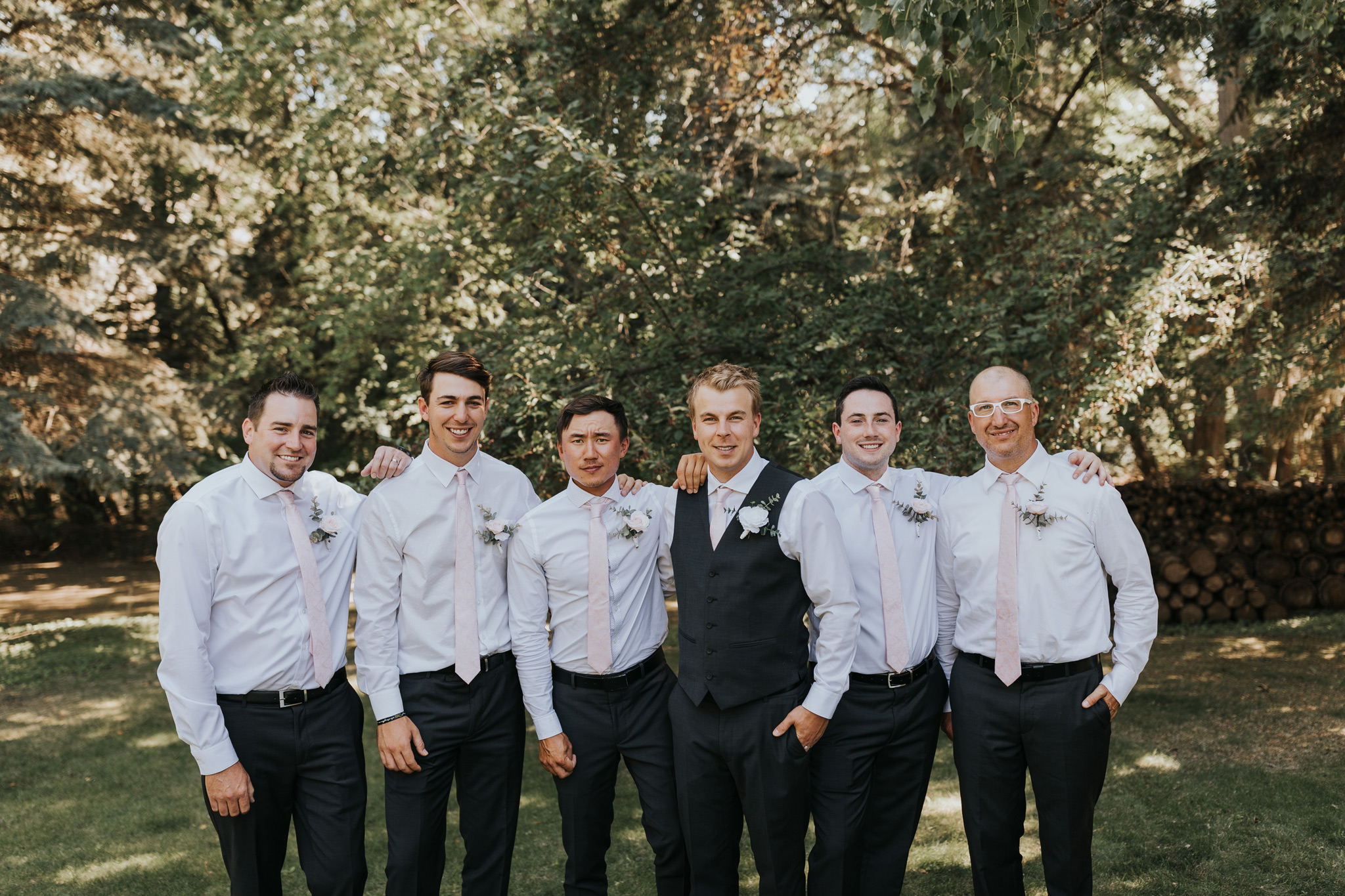 groom poses with groomsmen