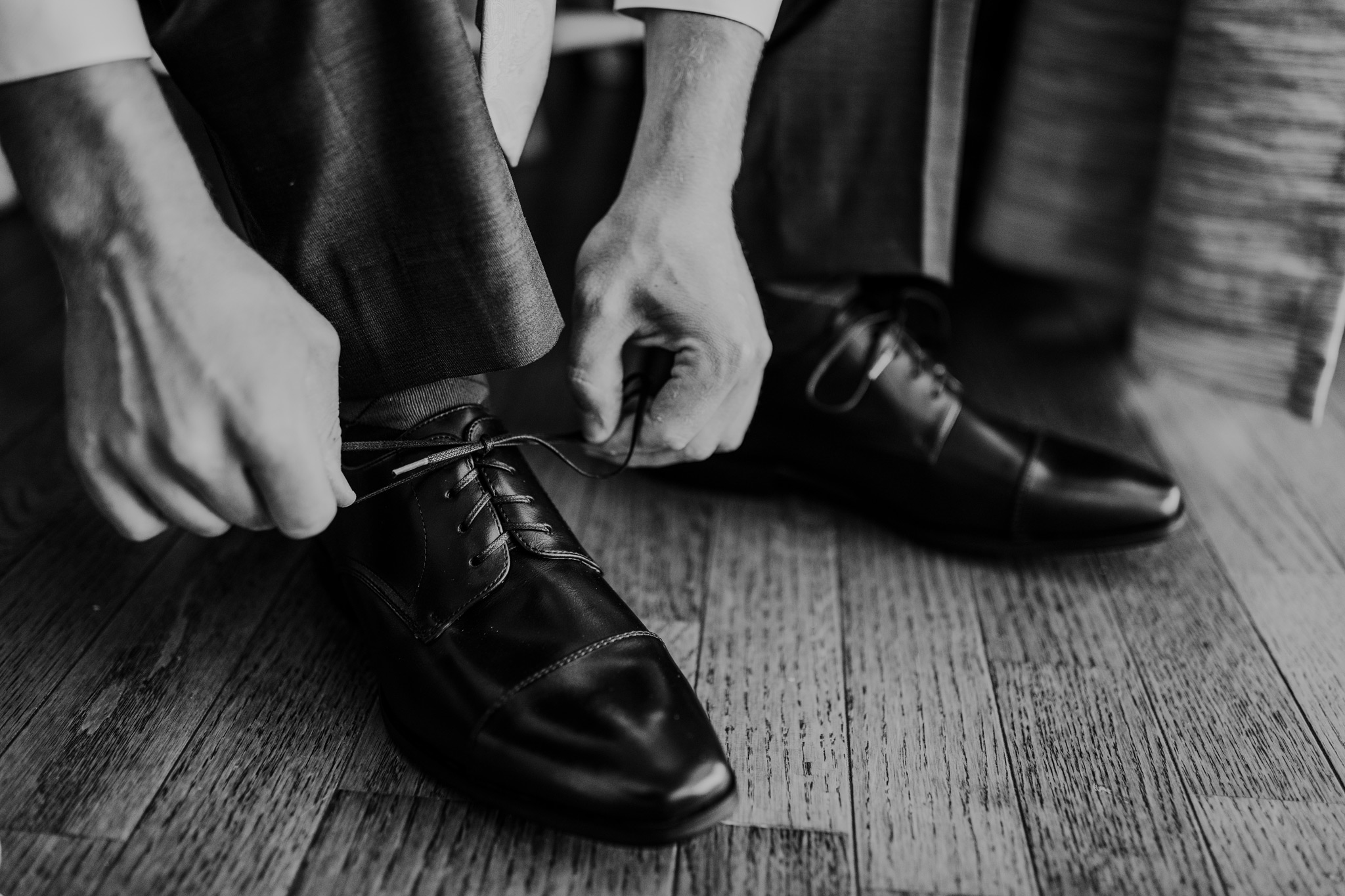 groom tying shoe for wedding medicine hat alberta