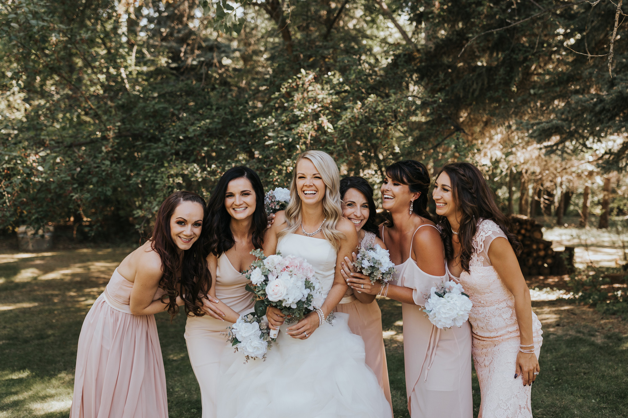 bridesmaids laughing and smiling with bride