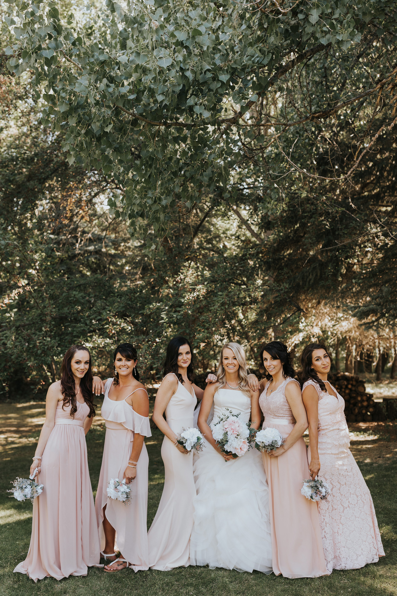 bride with bridal party posing