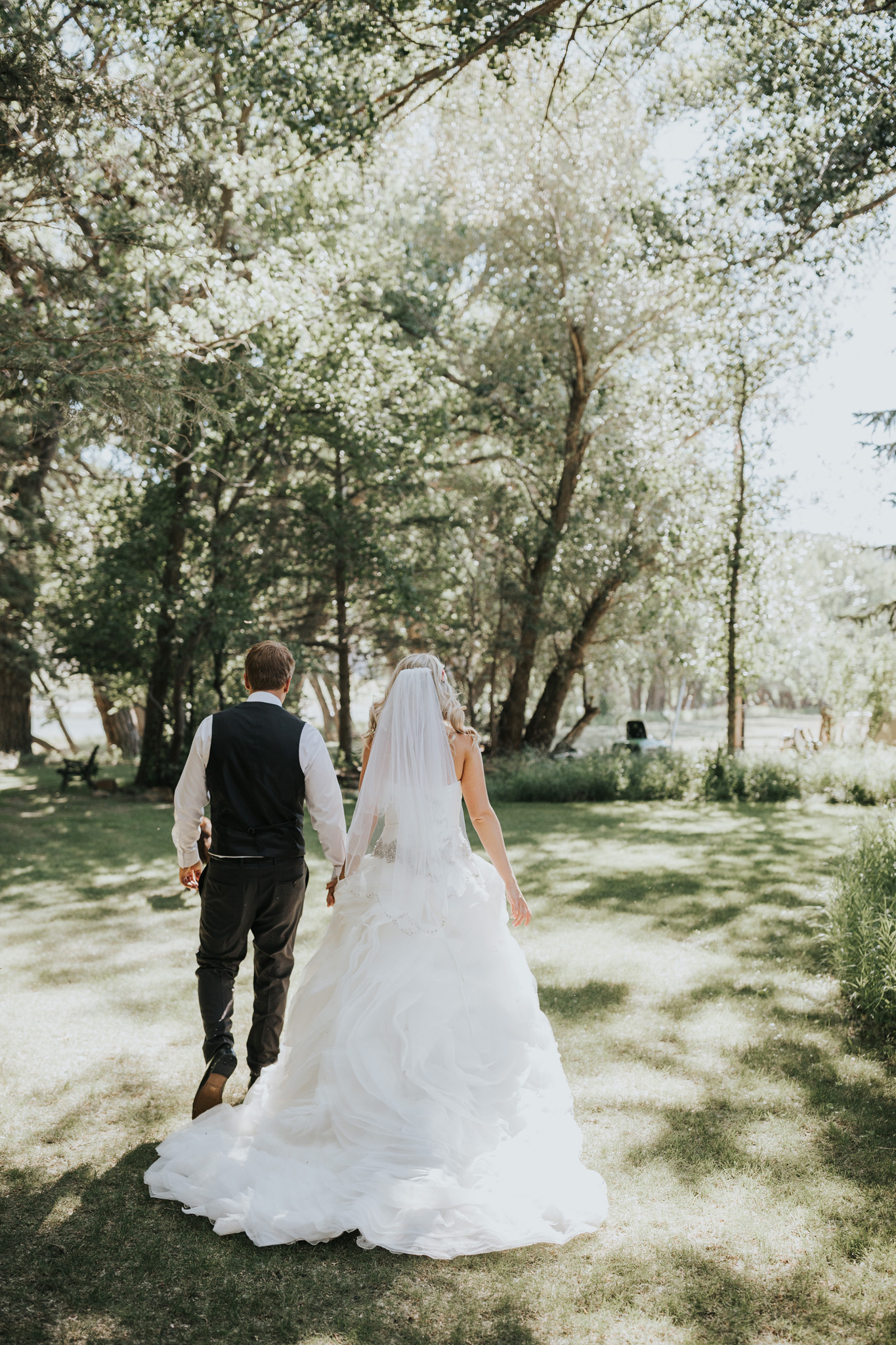 bride and groom holding hands walking
