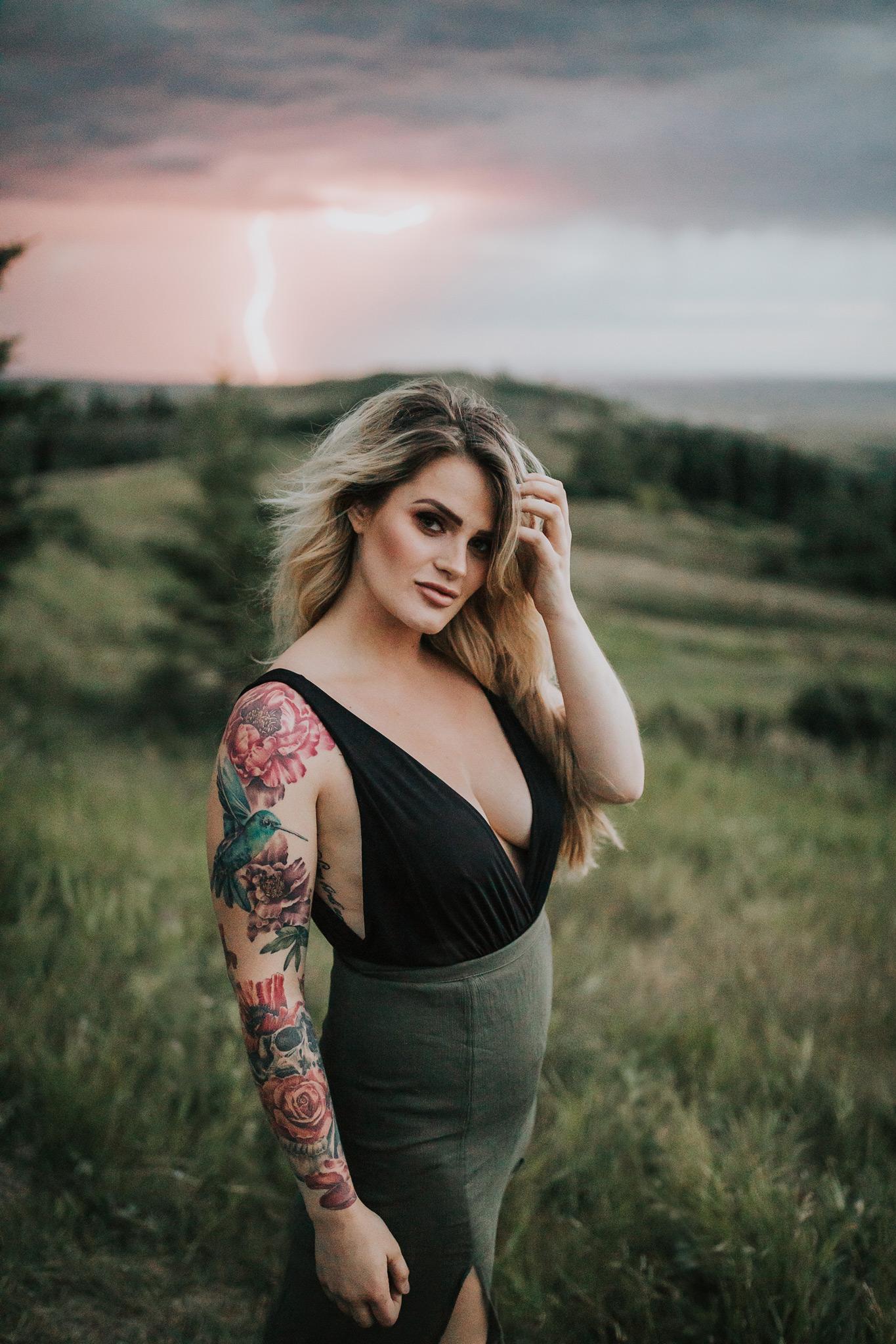 woman standing in front of lightning strike stormy reesor lake portrait boudoir