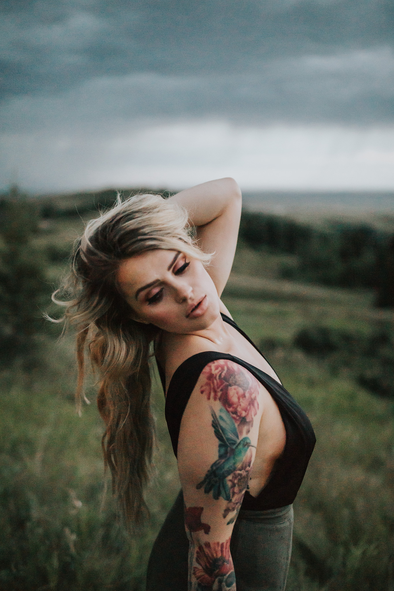 woman posing hand in hair reesor lake alberta portrait photography