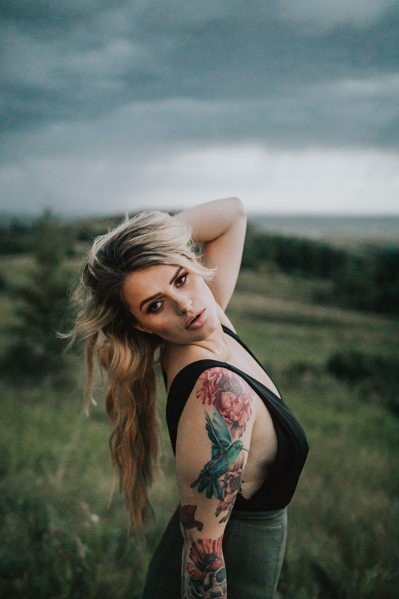 woman posing hand in hair reesor lake alberta storm portrait photography