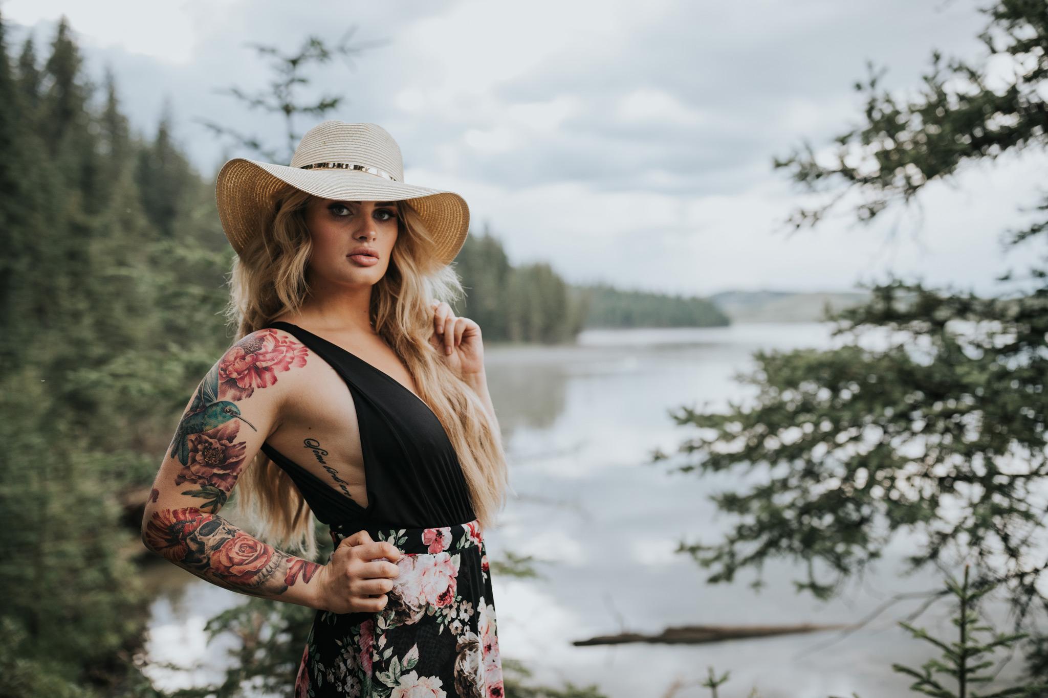 woman standing by reesor lake wearing floppy hat