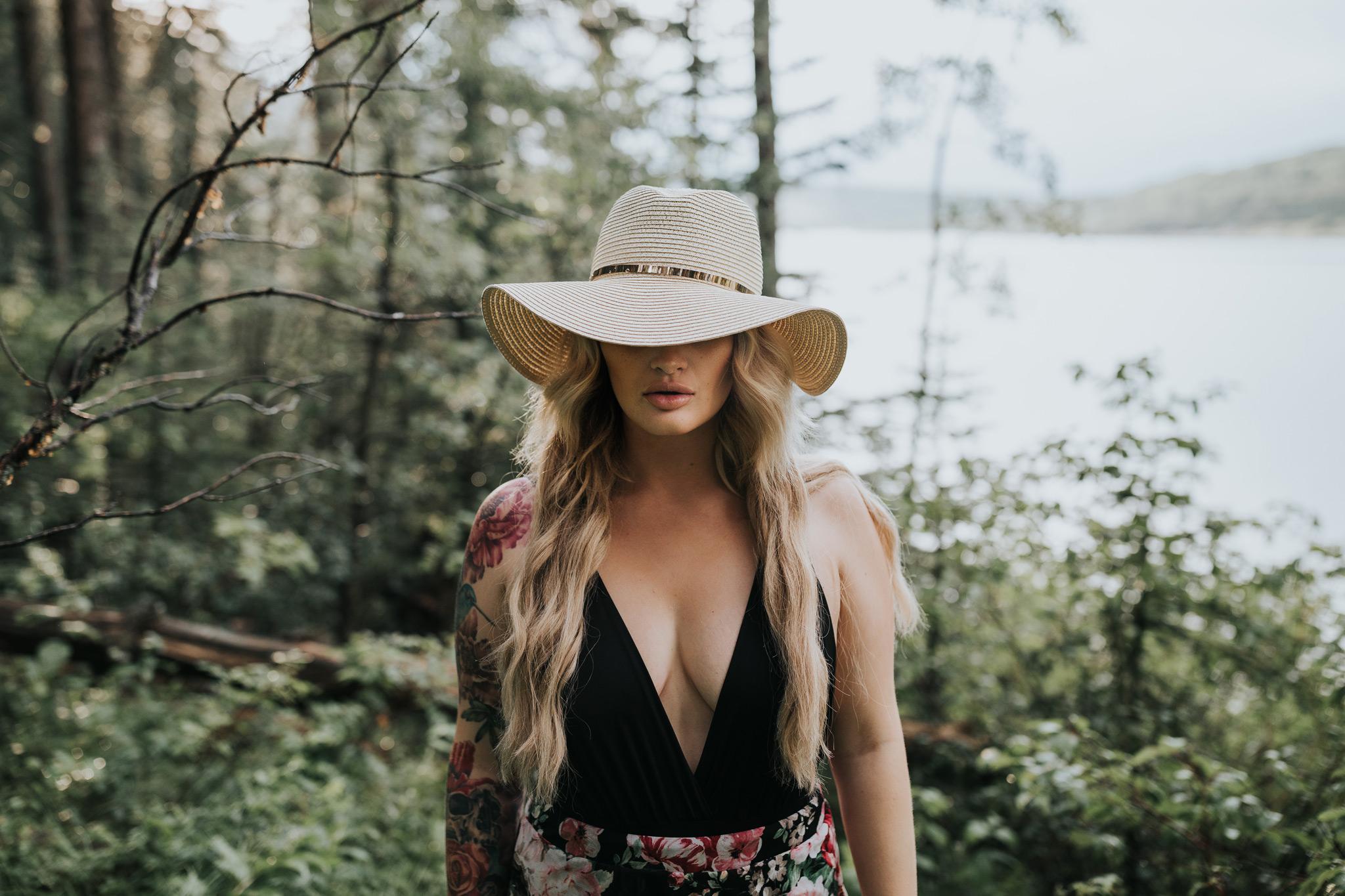 woman wearing hat covering eyes at reesor lake alberta