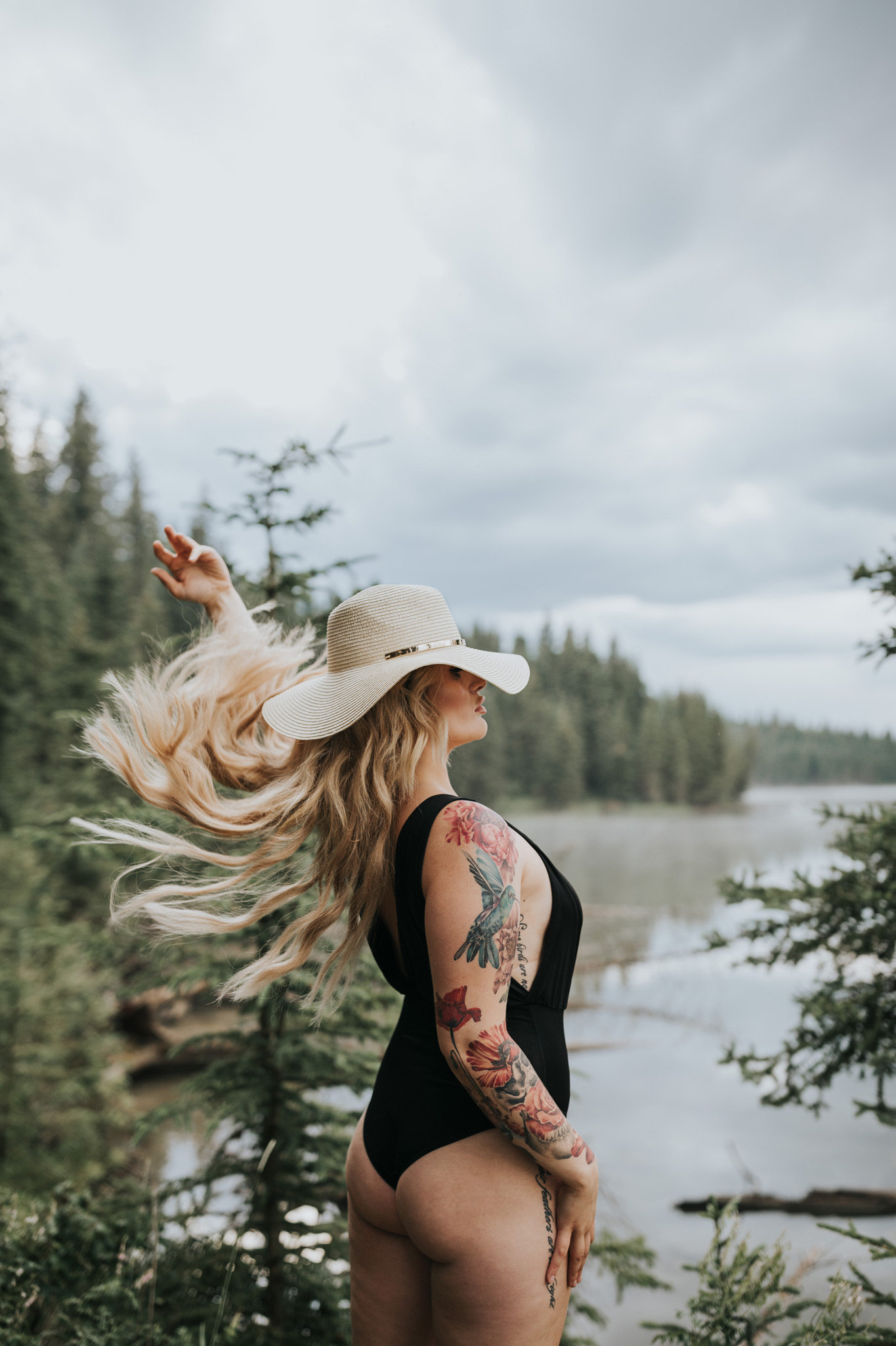 woman standing by reesor lake alberta hair flip