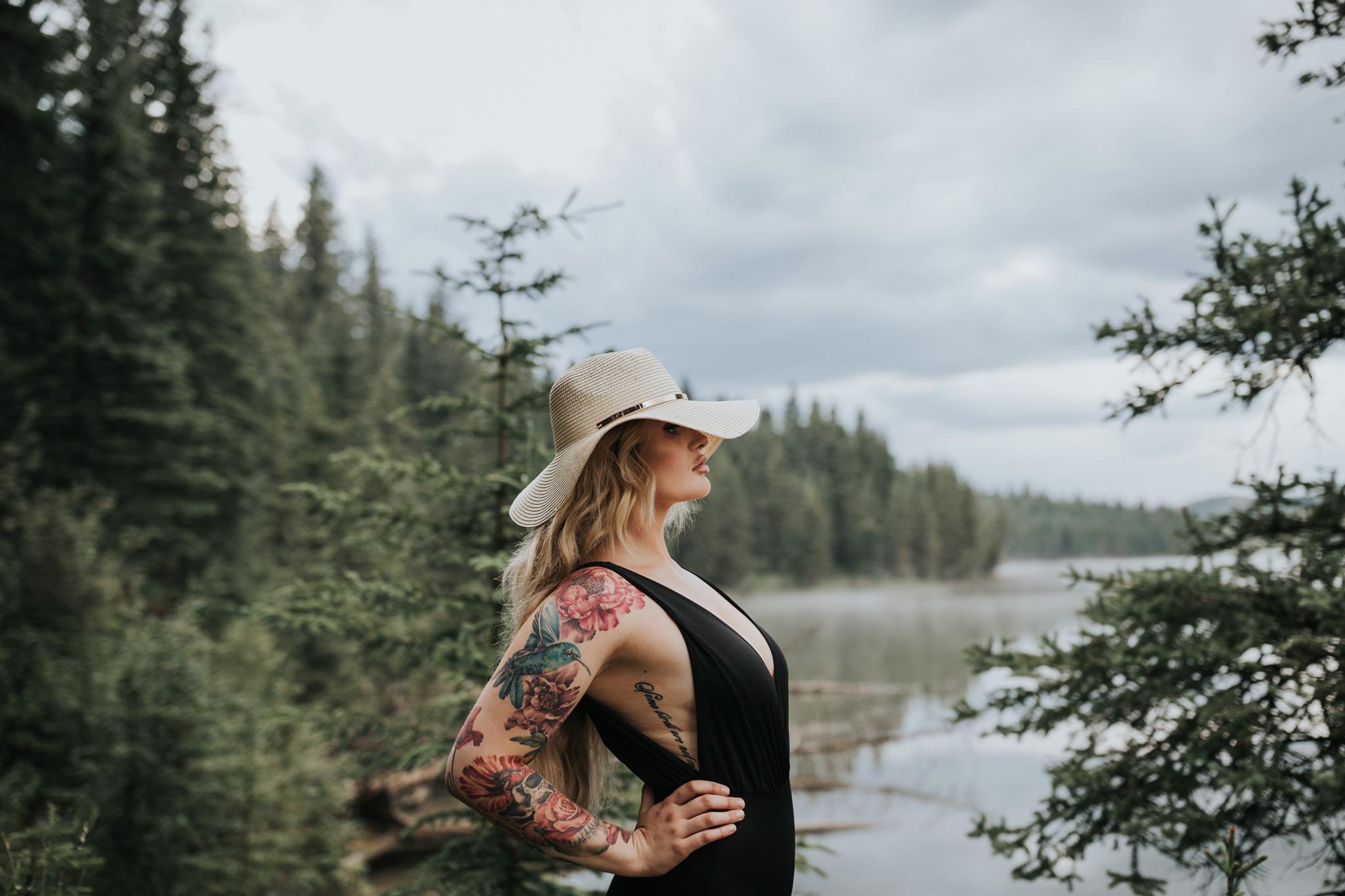 woman wearing hat standing proudly by reesor lake alberta