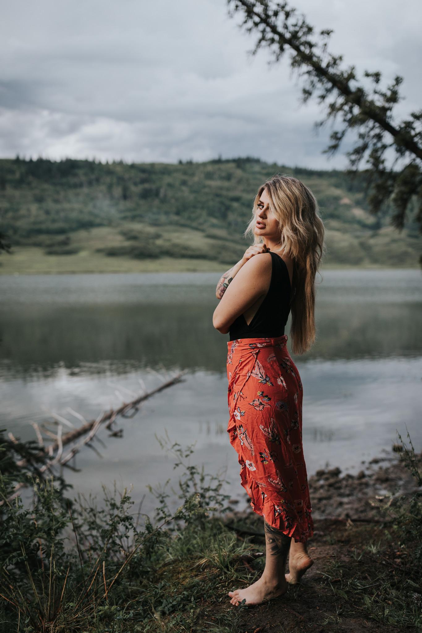 woman looking back over shoulder in reesor lake alberta
