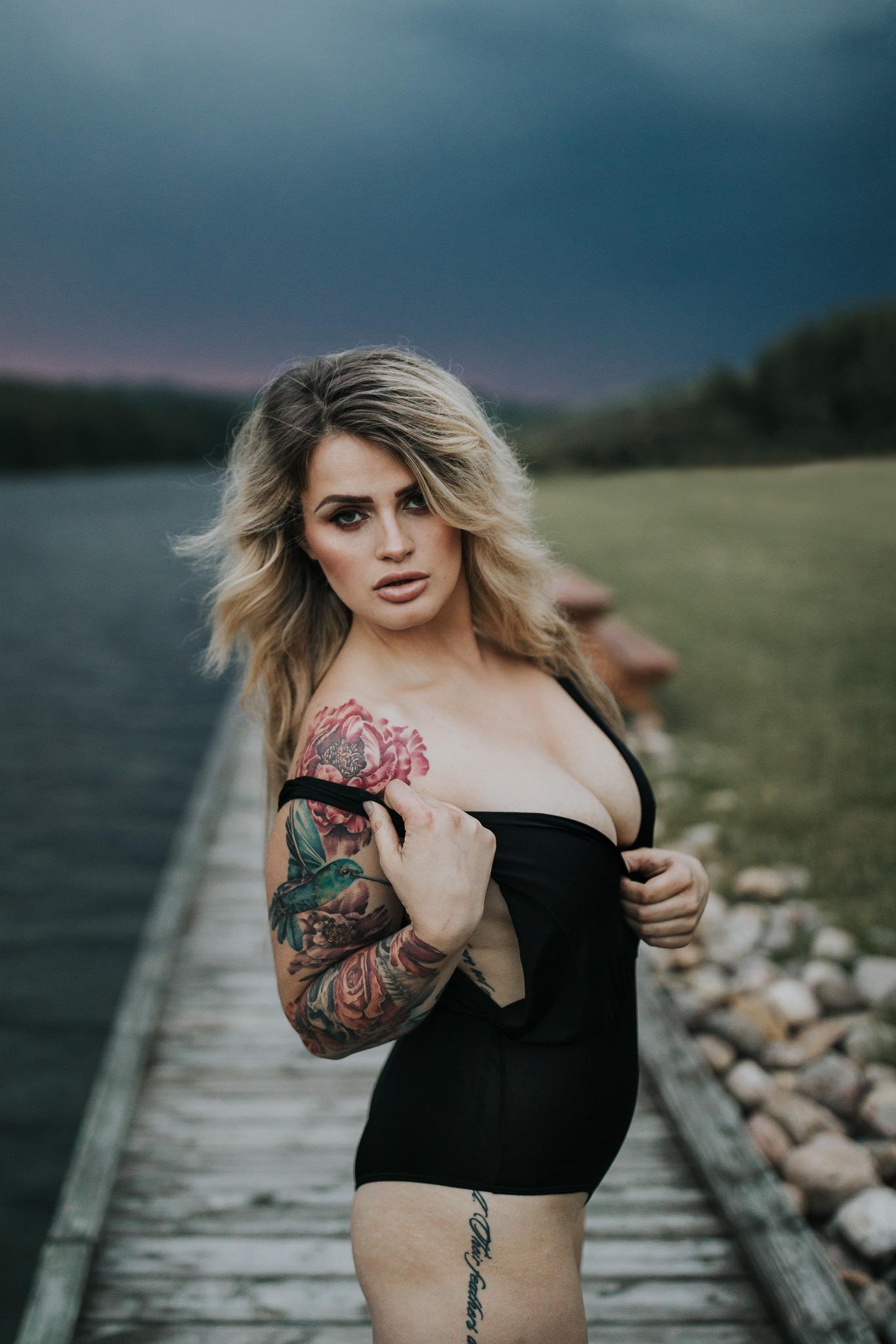 woman posing at reesor lake alberta stormy sunset outdoor boudoir