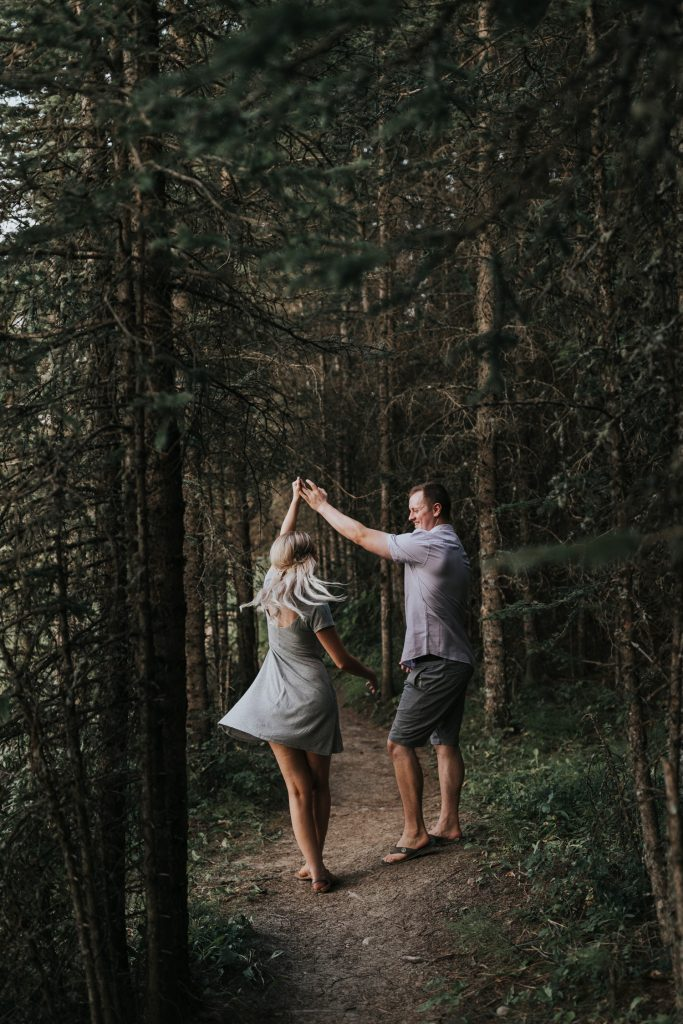 man twirls his fiancé dancing cypress hills forest