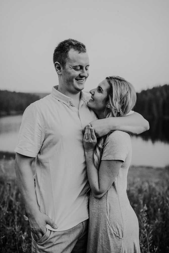 couple smiles at each other cypress hills alberta engagement
