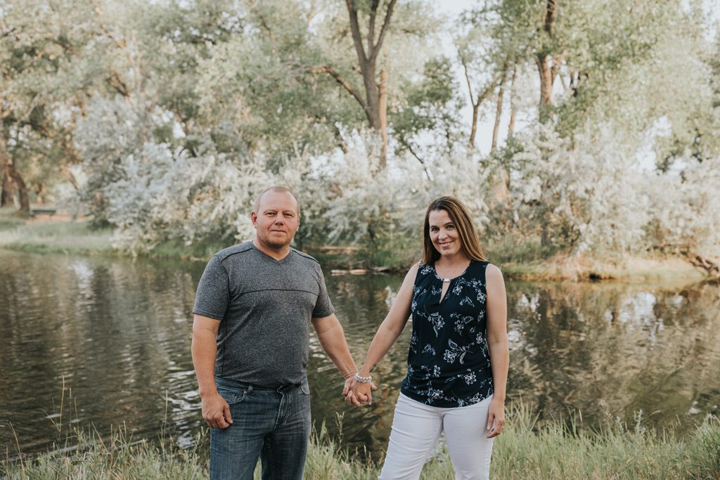 married couple holding hands by lake strathcona