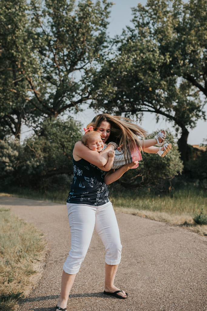 grandma scoops up granddaughter candid family photo