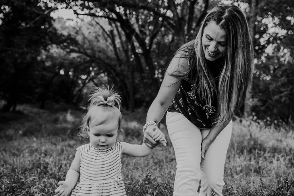 toddler walks with grandma medicine hat candid family photo