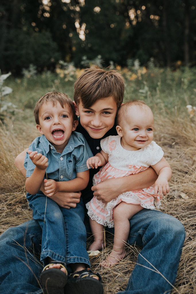 three siblings smiling medicine hat