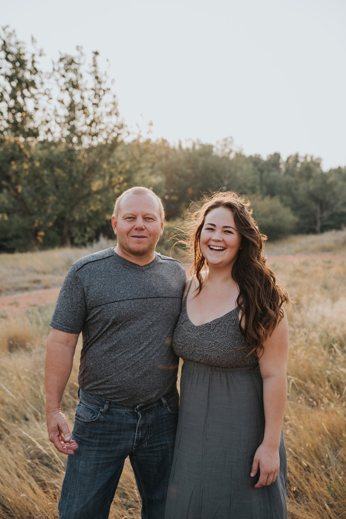 dad poses with daughter family photo laughing