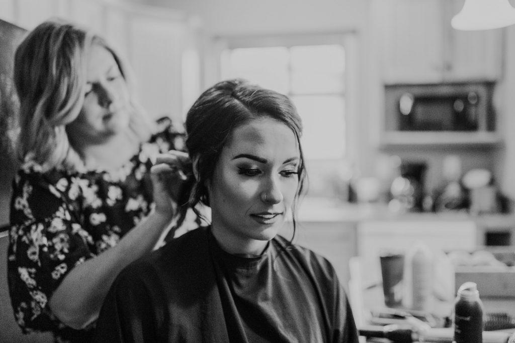 bride having hair done wedding elkwater lake lodge