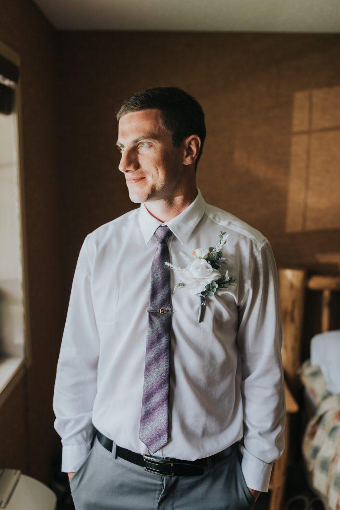 portrait groom elkwater lake lodge
