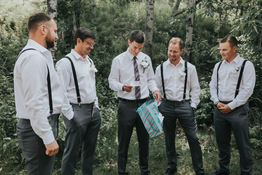 groom opening wedding gift from bride