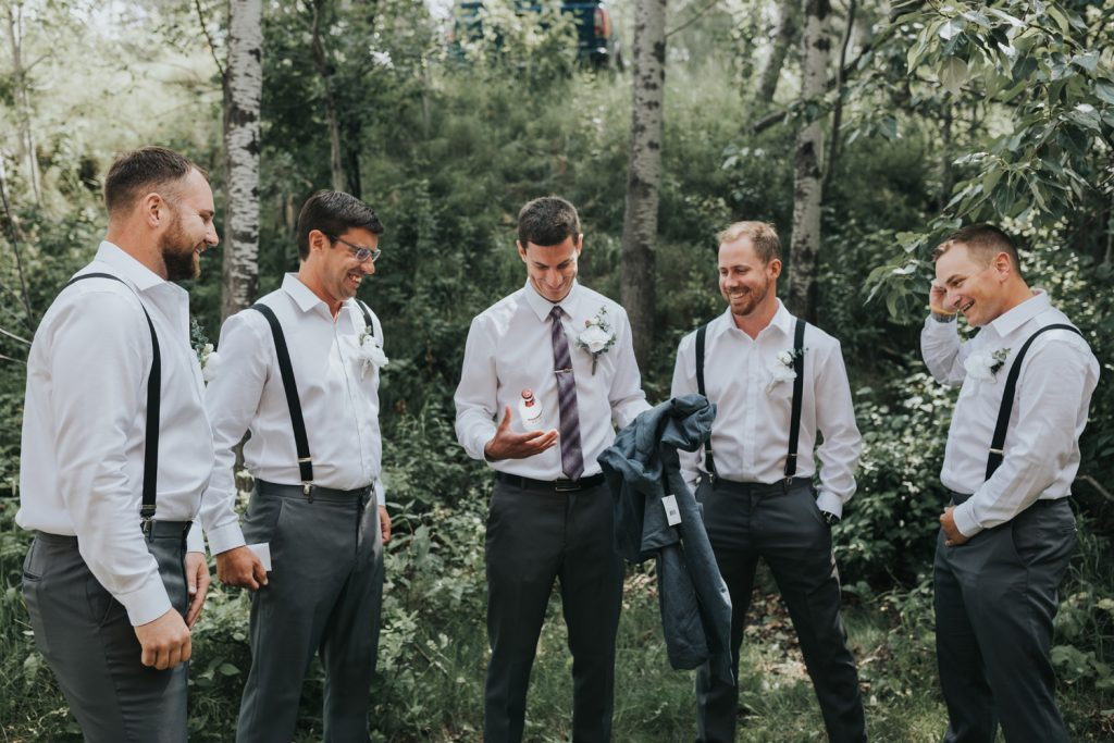 groom opens gift to find sweater and smirnoff ice
